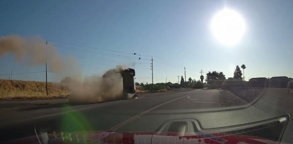Wild moment car flies over highway & crash lands but driver survives